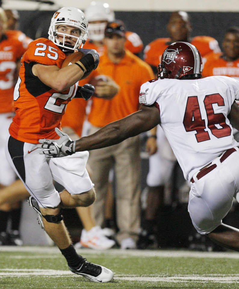 OSU's Josh Cooper (25) avoids Brandon Boudreaux (46) of Troy on a punt return for a touchdown in the third quarter during the college football game between the Oklahoma State University Cowboys (OSU) and the Troy University Trojans at Boone Pickens Stadium in Stillwater, Okla., Saturday, Sept. 11, 2010. OSU won, 41-38. Photo by Nate Billings, The Oklahoman