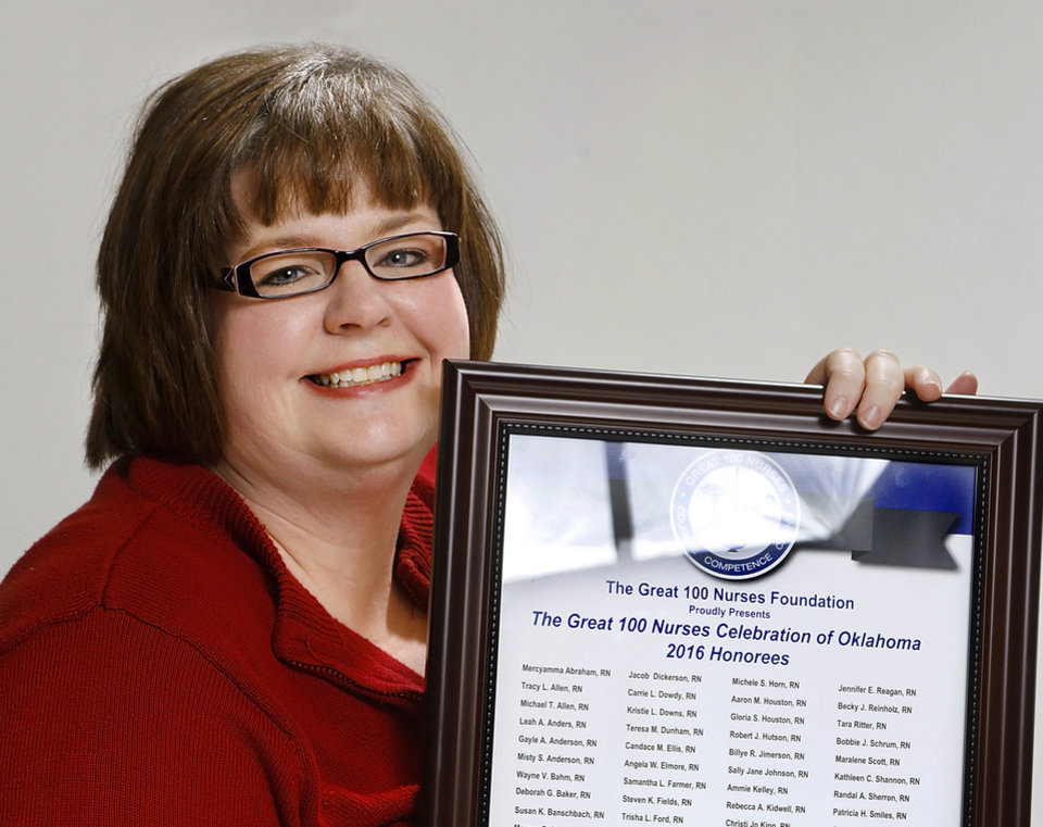 Photo -  Rebekah Gossett, population care management supervisor at the Oklahoma Health Care Authority, was named a 2016 Great 100 Nurses honoree and was also nominated for the March of Dimes Nurse of the Year award in the public health category. She is shown with her Great Nurses plaque at authority's office in Oklahoma City. [Photo by Jim Beckel, The Oklahoman]