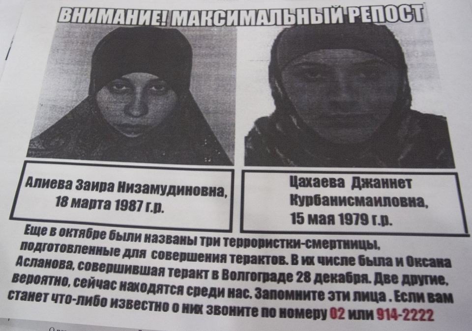 Photo - A photo of a police leaflet seen in a Sochi hotel on Tuesday, Jan. 21, 2014, depicting Dzhannet Tsakhayeva, right, and Zaira Aliyeva. Russian security officials are hunting down three potential female suicide bombers, one of whom is believed to be in Sochi, where the Winter Olympics will begin next month. Police leaflets seen by an Associated Press reporter at a central Sochi hotel on Tuesday contain warnings about three potential suicide bombers. The police leaflet reads: