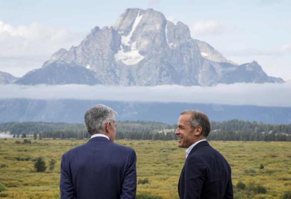 Photo - Federal Reserve Chairman Jerome Powell, left, and Bank of England Governor Mark Carney, right, walk together after Powell's speech at the Jackson Hole Economic Policy Symposium on Friday, Aug. 23, 2019, in Jackson Hole, Wyo. (AP Photo/Amber Baesler)