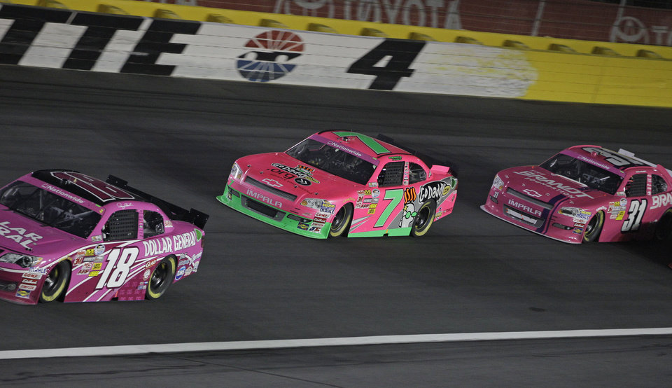 Danica Patrick (7) races Denny Hamlin (18) and Justin Allgaier (31) during the NASCAR Dollar General 300 Nationwide Series auto race in Concord, N.C., Friday, Oct. 12, 2012. (AP Photo/Chuck Burton)