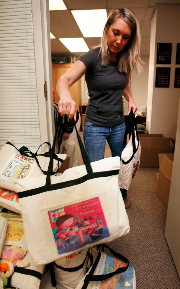 University of Oklahoma College of Education early childhood education senior Katie Stone, from Oklahoma City, moves books and book bags bound for New Orleans at Collings Hall in Norman, Oklahoma on Tuesday, February 20, 2008. BY STEVE SISNEY, THE OKLAHOMAN
