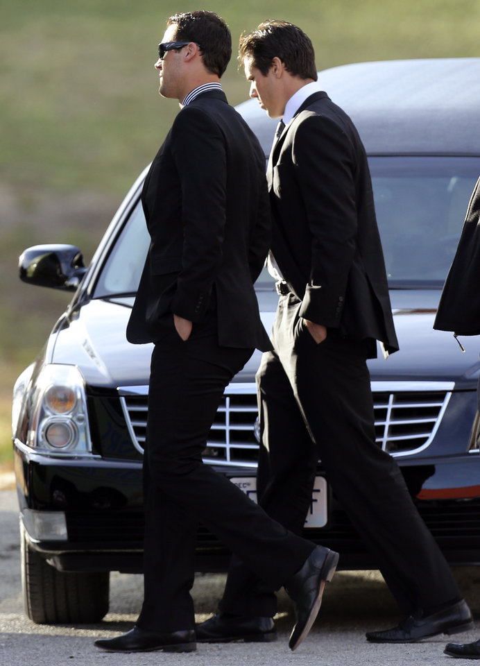 Photo - Kansas City Chiefs quarterbacks Brady Quinn, right, and Matt Cassel leave a memorial service for Jovan Belcher at the Landmark International Deliverance and Worship Center, Wednesday, Dec. 5, 2012, in Kansas City, Mo. Belcher shot his girlfriend, Kasandra Perkins, at their home Saturday morning before driving to Arrowhead Stadium and turning the gun on himself. (AP Photo/Ed Zurga)