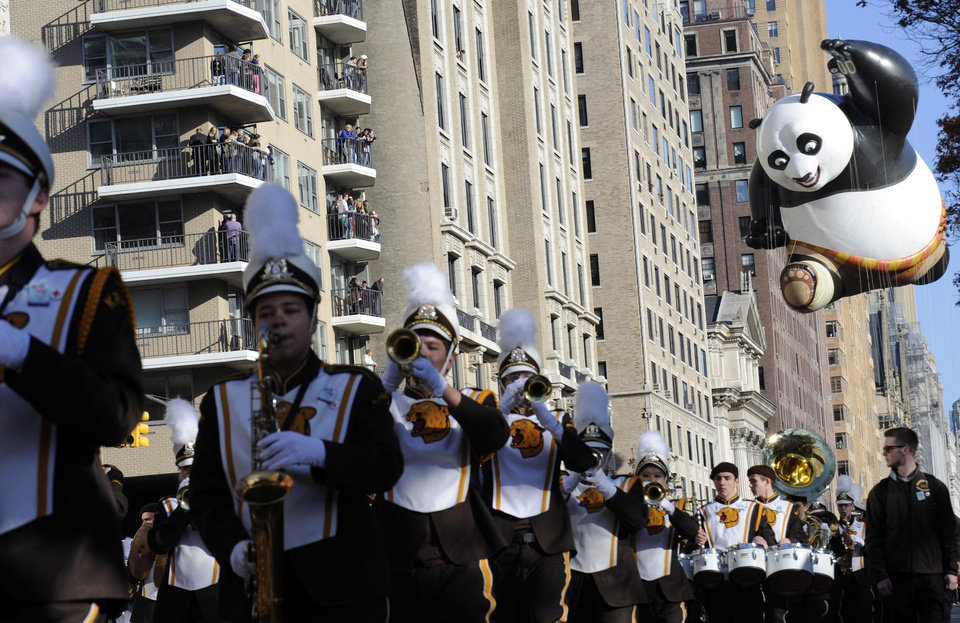 Photo -   The Kung Fu Panda balloon, right, participates in the 86th annual Macy's Thanksgiving Day Parade,Thursday, Nov 22, 2012, in New York. (AP Photo/ Louis Lanzano)