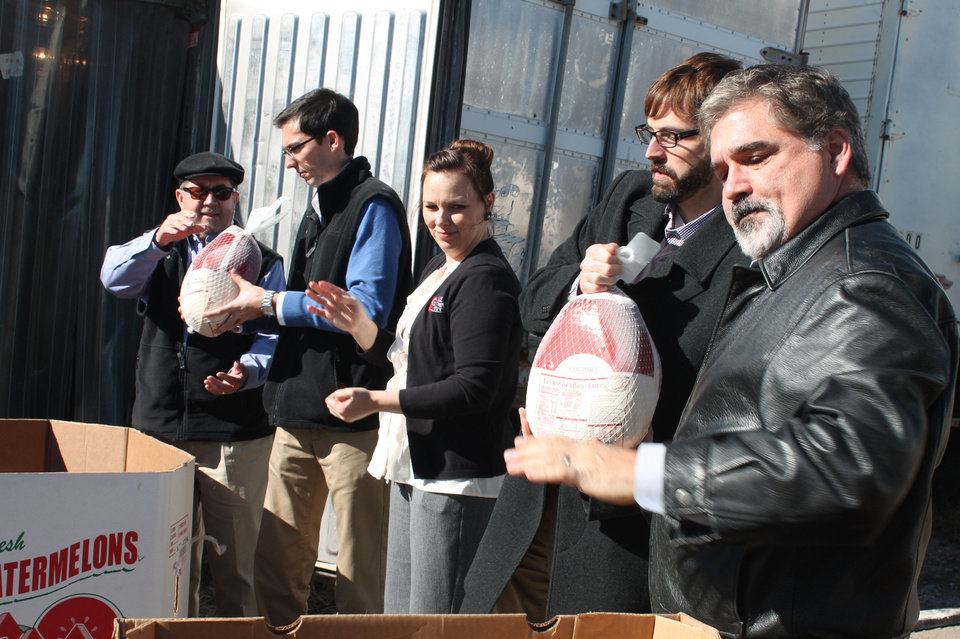 Staff from the GableGotwals law firm deliver turkeys to the Jesus House for the charity's 2013 Thanksgiving food baskets.Photo provided <strong></strong>