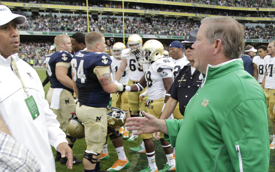 Photo -   Notre Dame head coach Brian Kelly, right, shakes hands with Navy head coach Ken Niumatalolo after their NCAA college football game in Dublin, Ireland, Saturday, Sept. 1, 2012. (AP Photo/Peter Morrison)