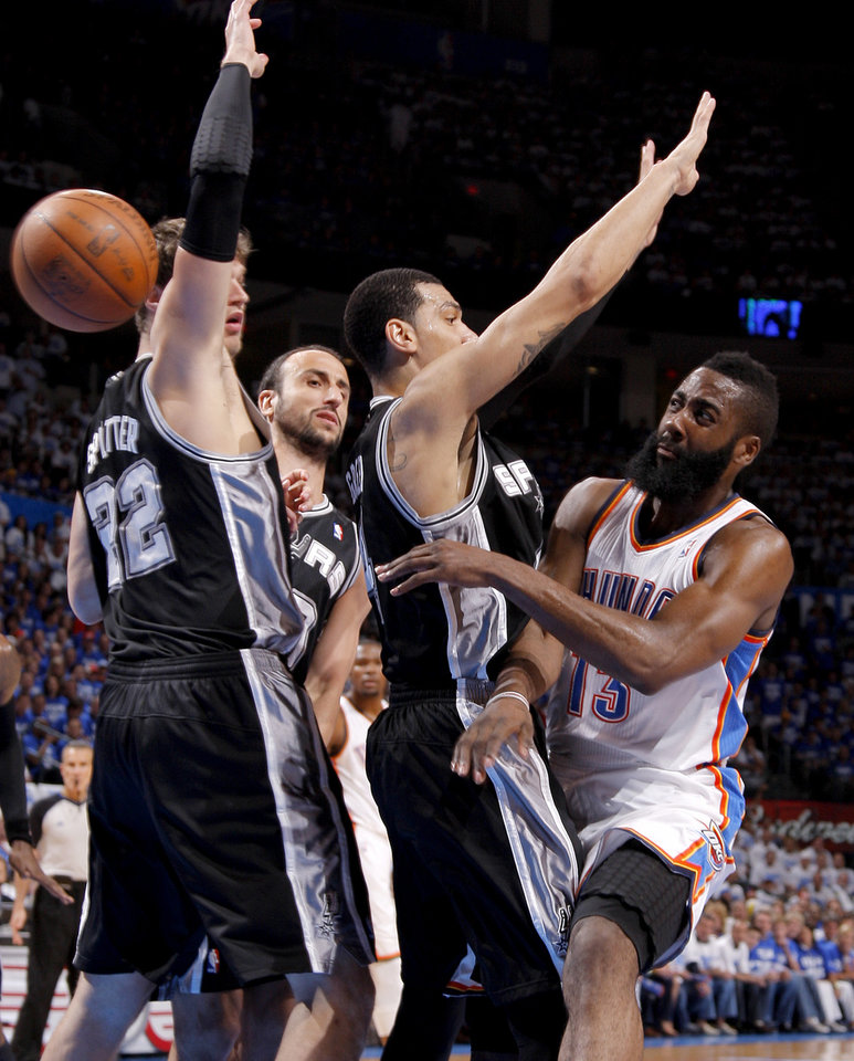 Oklahoma City's James Harden (13) passes the ball around San Antonio's Tiago Splitter (22), Manu Ginobili (20), and Danny Green (4) during Game 4 of the Western Conference Finals between the Oklahoma City Thunder and the San Antonio Spurs in the NBA playoffs at the Chesapeake Energy Arena in Oklahoma City, Saturday, June 2, 2012. Photo by Bryan Terry, The Oklahoman