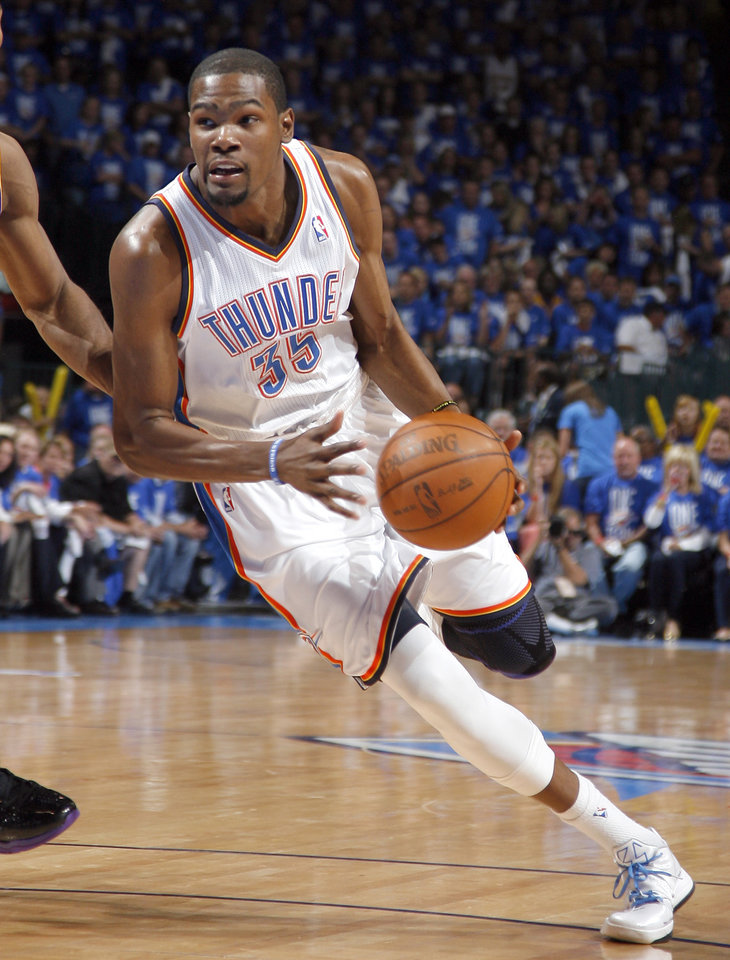 Photo - Oklahoma City's Kevin Durant (35) drives to the basket during Game 1 in the second round of the NBA playoffs between the Oklahoma City Thunder and the L.A. Lakers at Chesapeake Energy Arena in Oklahoma City, Monday, May 14, 2012. Photo by Sarah Phipps, The Oklahoman
