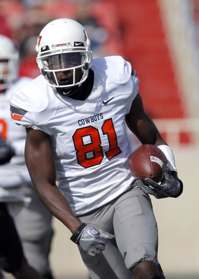 OSU receiver Justin Blackmon, shown here during a November game vs. Texas Tech, impressed NFL scouts and coaches with his speed at OSU's Pro Day on Friday in Stillwater. PHOTO BY SARAH PHIPPS, The Oklahoman <strong>SARAH PHIPPS</strong>