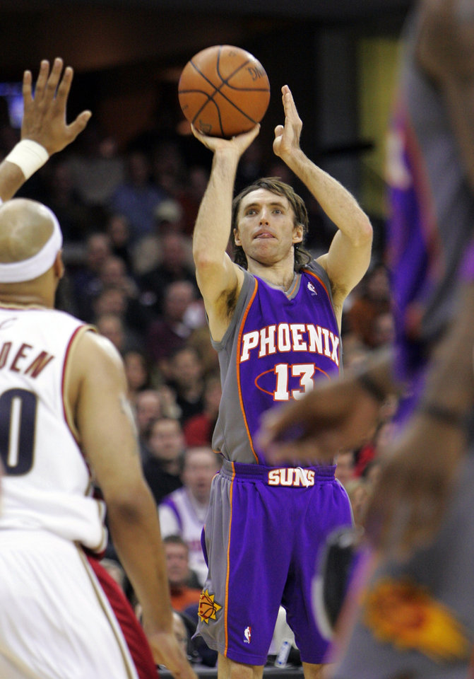 Photo - Phoenix Suns' Steve Nash goes up for a 3-point shot in the third quarter of an NBA basketball game against the Cleveland Cavaliers on Friday, Jan. 25, 2008, in Cleveland. Nash scored 26 points to help Phoenix to a 110-108 win. (AP Photo/Mark Duncan) ORG XMIT: OHMD106