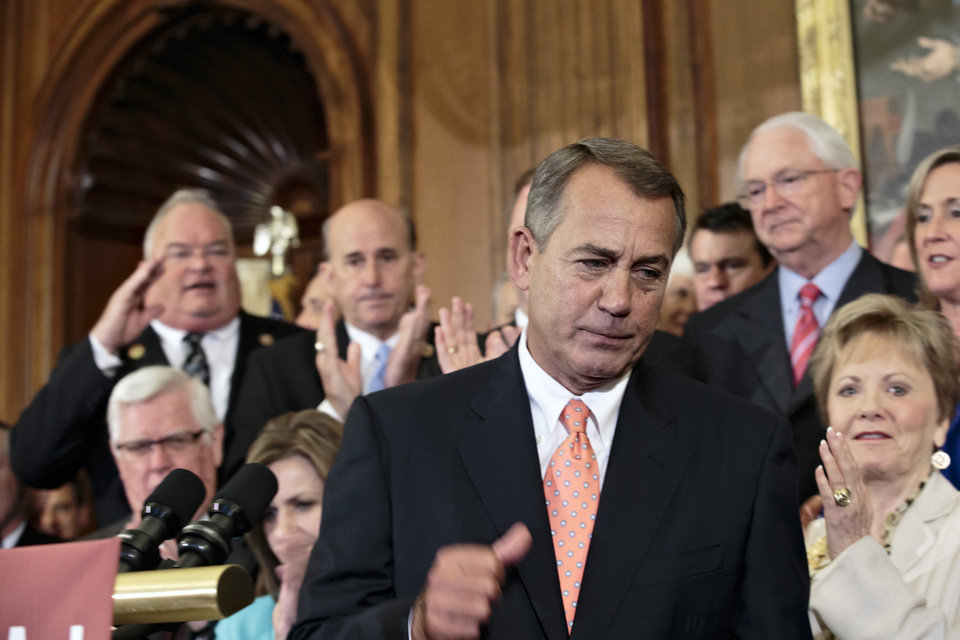 Photo - Speaker of the House John Boehner, R-Ohio and Republican members of the House of Representatives rally after passing a bill that would fund the government for three months while crippling the health care law that was the signature accomplishment of President Barack Obama's first term, at the Capitol in Washington, Friday, Sept. 20, 2013. Senate Majority Leader Harry Reid, D-Nev., has pronounced the bill dead on arrival and calls the House exercise a
