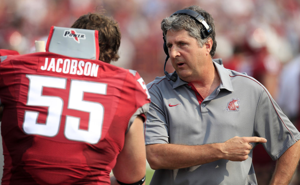 Photo -   Washington State coach Mike Leach, right, talks to offensive lineman Wade Jacobson (55) during the first half of an NCAA college football game against Colorado, Saturday, Sept. 22, 2012, at Martin Stadium in Pullman, Wash. (AP Photo/Dean Hare)