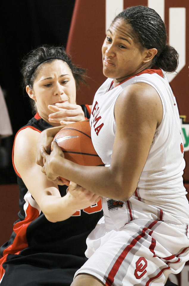 Oklahoma's Ashley Paris, right and Texas Tech's Jordan Murphree fight for the ball on Wednesday. Photo BY NATE BILLINGS, THE OKLAHOMAN