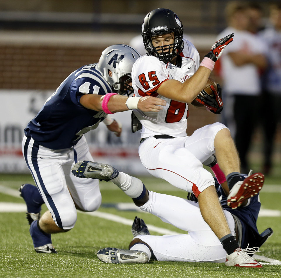 Yukon\'s Codey Sanchez tries to get past Edmond North\'s Scott Courtney during their high school football game at Wantland Stadium in Edmond, Okla., Thursday, October 4, 2012. Photo by Bryan Terry, The Oklahoman