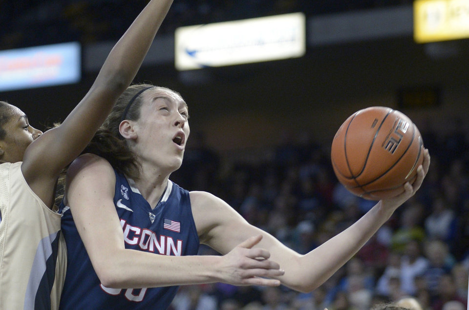 Photo - FILE - In this Jan. 1, 2014 file photo, Connecticut forward Breanna Stewart, right, goes up for a shot in front of Central Florida forward Stephanie Taylor (42) during the first half of an NCAA college basketball game in Orlando, Fla. Stewart was selected to The Associated Press women's basketball All-America team, released Tuesday, April 1, 2014. (AP Photo/Phelan M. Ebenhack, File)