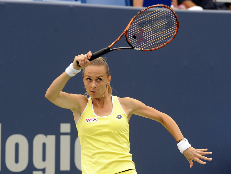 Photo - Magdalena Rybarikova, of Slovakia, watches her forehand during her 6-2, 6-4 semifinal victory over Camila Giorgi, of Italy, at the New Haven Open tennis tournament in New Haven, Conn., on Friday, Aug. 22, 2014. (AP Photo/Fred Beckham)