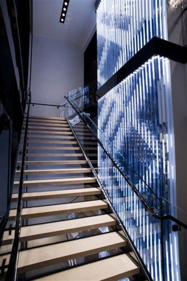 This undated publicity photo provided by BURBERRY shows an interior staircase of the new BURBERRY Flagship store opened in November 2012 on Michigan Avenue in Chicago. BURBERRY has been known for generations for its signature check pattern and trenchcoat. (AP Photo/BURBERRY)