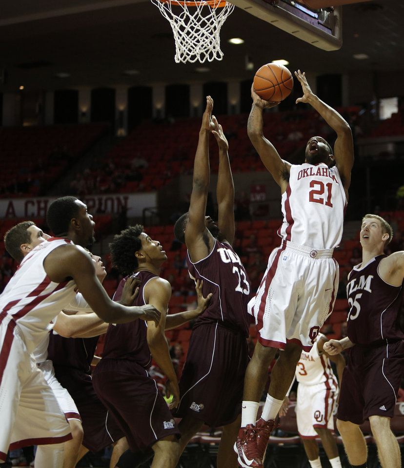 Photo - Oklahoma's Cameron Clark (21) takes a shot during a men's college basketball game between the University of Oklahoma and the University of Louisiana-Monroe at the Loyd Noble Center in Norman, Okla., Sunday, Nov. 11, 2012.  Photo by Garett Fisbeck, The Oklahoman
