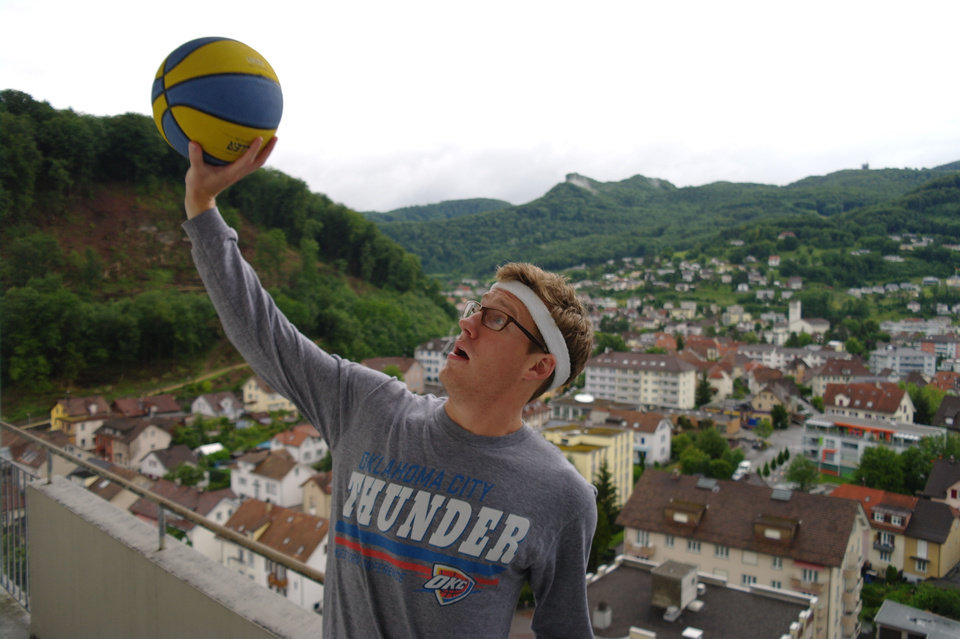 Photo - University of Central Oklahoma student Will Heckenkemper is studying abroad in Olten, Switzerland. He likes watching the games live, which means tipoff is usually between 2 and 3 a.m. Here, he shows off his Thunder gear in the Swiss town. Photo provided