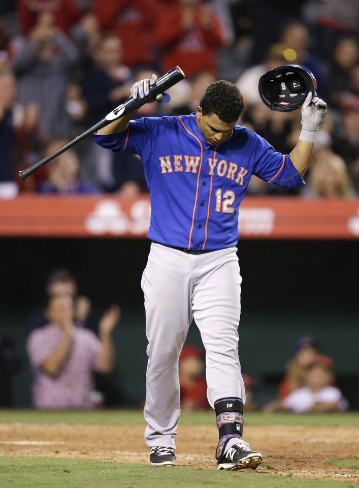 Photo - New York Mets' Juan Lagares reacts after he struck out during the 12th inning of a baseball game against the Los Angeles Angels on Saturday, April 12, 2014, in Anaheim, Calif. (AP Photo/Jae C. Hong)