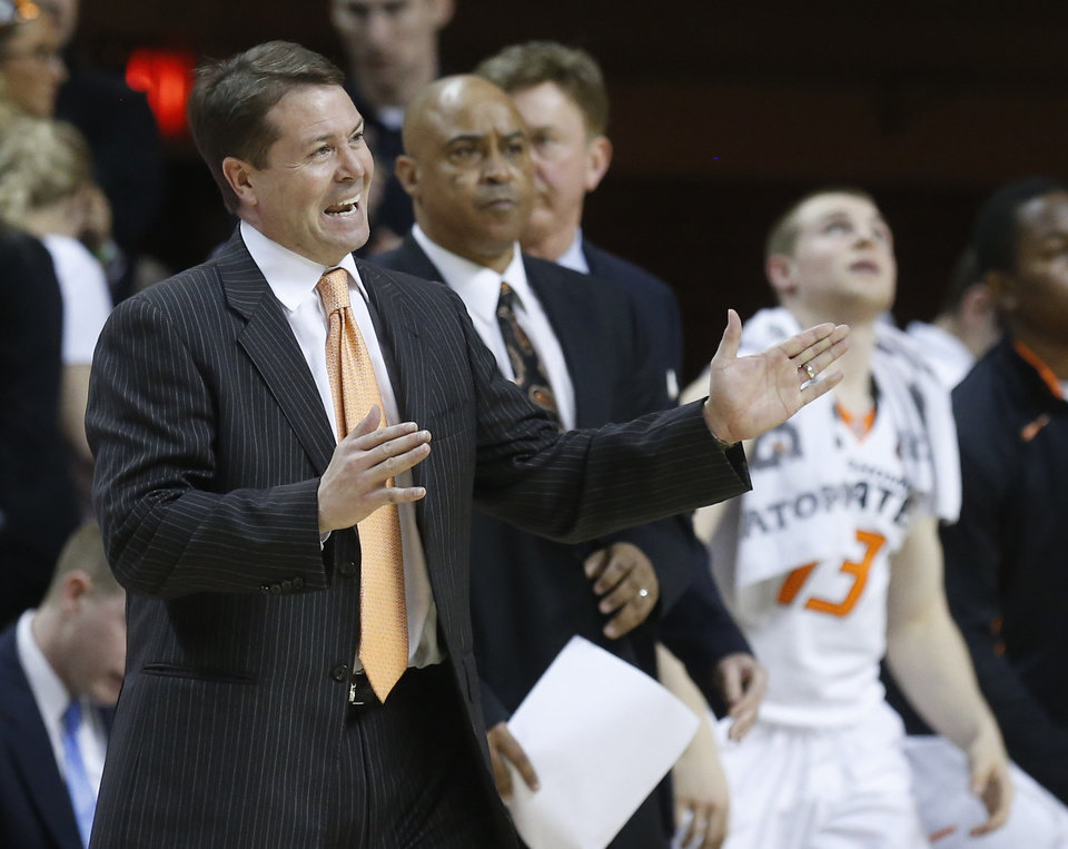 Photo - Oklahoma State head coach Travis Ford gestures during a time out in the second half of an NCAA college basketball game against Kansas State in Stillwater, Okla., Saturday, March 9, 2013. Oklahoma State won 76-70. (AP Photo/Sue Ogrocki)