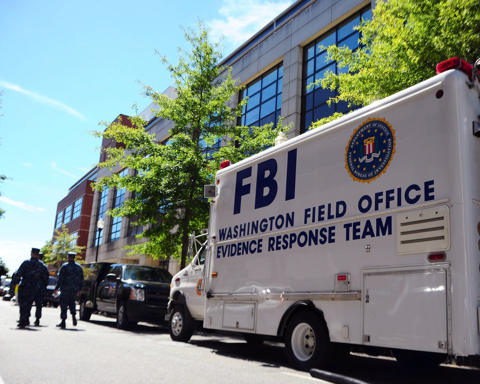 Photo - In this photo provided by the U.S. Navy, an FBI evidence response team vehicle is parked outside Building 197 at the Navy Yard in Washington as evidence is collected Wednesday, Sept. 18, 2013. A gunman killed 12 people at the base on Monday, Sept. 16, 2013. (AP Photo/U.S. Navy, Mass Communication Specialist 2nd Class Pedro A. Rodriguez)