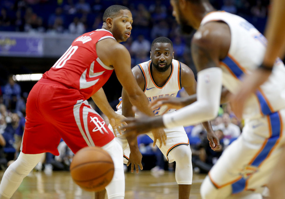 Photo -  Raymond Felton, center, has averaged 7.8 points, 2.3 assists and 17.8 minutes played in the Thunder's first 12 games this season. [Photo by Bryan Terry, The Oklahoman]