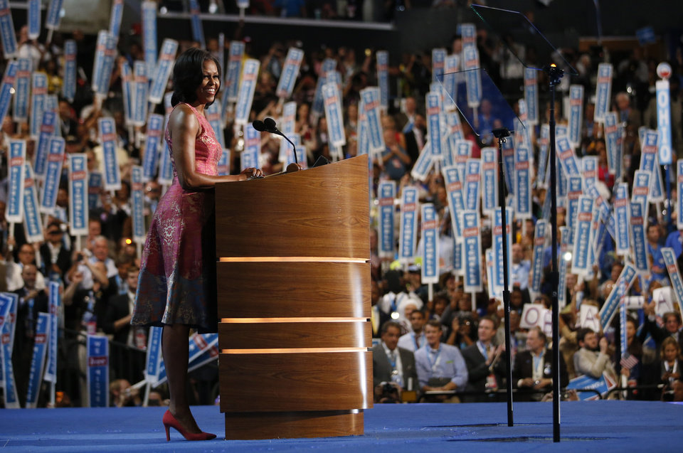 Photo - First Lady Michelle Obama addresses the Democratic National Convention in Charlotte, N.C., on Monday, Sept. 3, 2012. (AP Photo/Jae C. Hong)  ORG XMIT: DNC799
