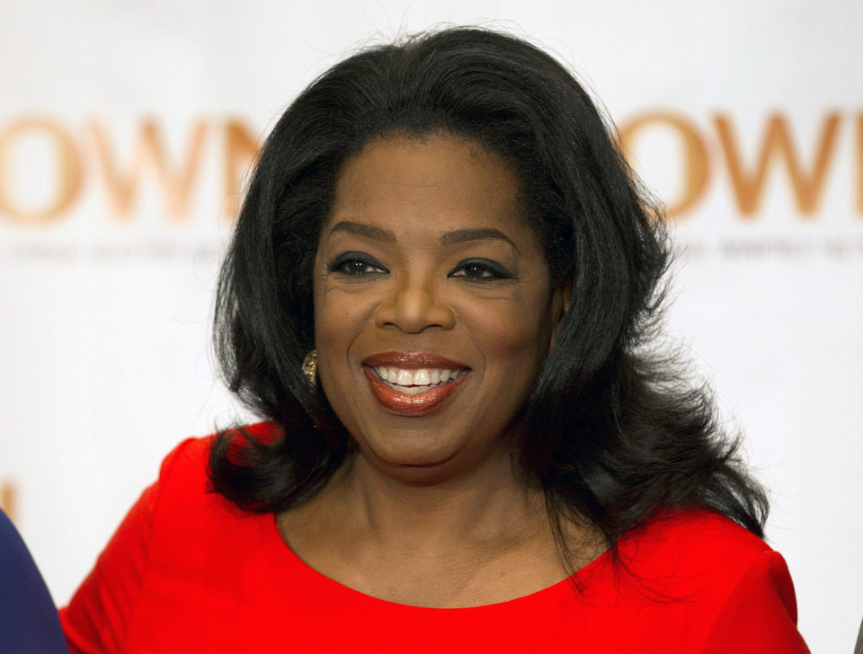"FILE - This April 16, 2012 file photo shows Oprah Winfrey in Toronto. Winfrey announced Wednesday, Dec. 5, that she has chosen a debut novel for her book club, ""The Twelve Tribes of Hattie,"" by Ayana Mathis. An author interview will be aired Feb. 3, 2013 on Winfrey's OWN network. (AP Photo/The Canadian Press, Frank Gunn, file)"