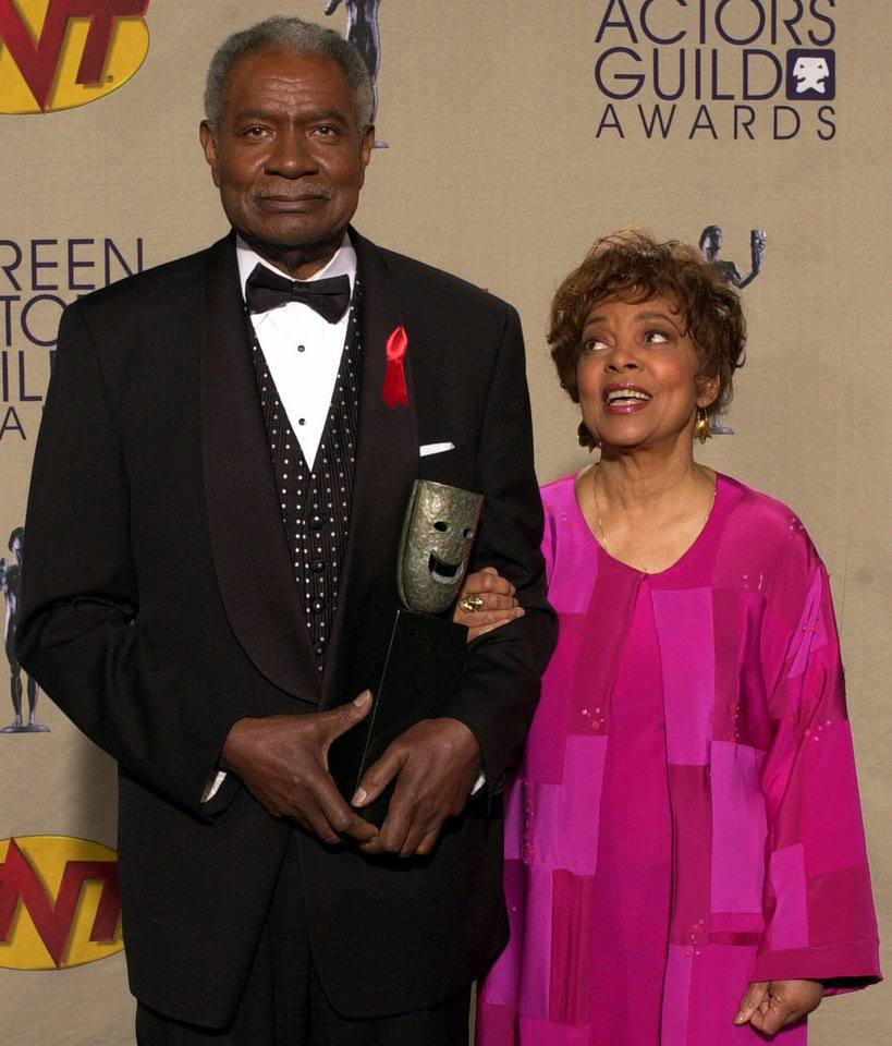 Photo - FILE - In this March 11, 2001 file photo, lifetime achievement award winners Ossie Davis and Ruby Dee pose with their award at the 7th annual Screen Actors Guild Awards, in Los Angeles. Dee, an acclaimed actor and civil rights activist whose versatile career spanned stage, radio television and film, has died at age 91, according to her daughter. Nora Davis Day told The Associated Press on Thursday, June 11, 2014, that her mother died at home at New Rochelle, New York, on Wednesday night. (AP Photo/Michael Caulfield, file)