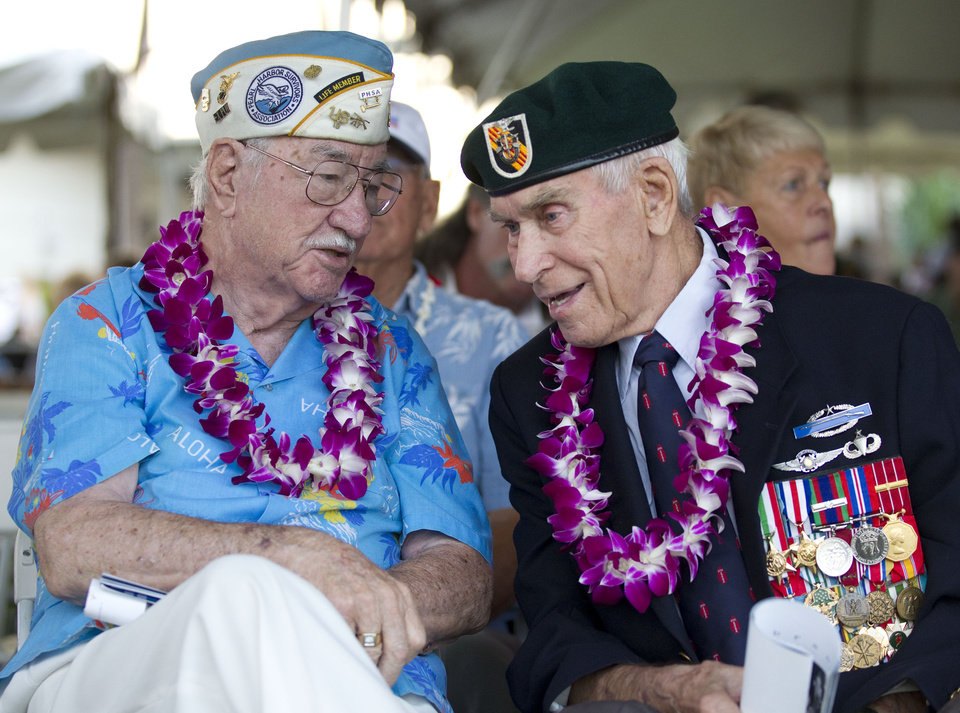 Photo - Pearl Harbor survivor Sam Clower, left, of Sacramento, Calif. and Ab Brum, right, , retired United States Army Special Forces, of Kaneohe, Hawaii, share memories of the Japanese attack on Pearl Harbor Friday, Dec. 7, 2012, at Pearl Harbor, Hawaii. Many of the Pearl Harbor Veterans gathered at the World War II Valor In The Pacific National Monument remembering the 71th anniversary of the Dec. 7, 1941 Japanese surprise attack on Pearl Harbor in Honolulu. (AP Photo/Eugene Tanner)