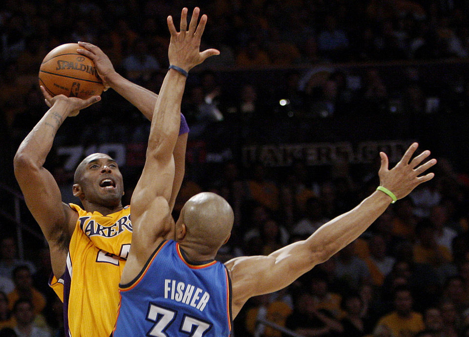 Photo - Los Angeles' Kobe Bryant (24) shoots over Oklahoma City's Derek Fisher (37) during Game 3 in the second round of the NBA basketball playoffs between the L.A. Lakers and the Oklahoma City Thunder at the Staples Center in Los Angeles, Friday, May 18, 2012. Photo by Nate Billings, The Oklahoman