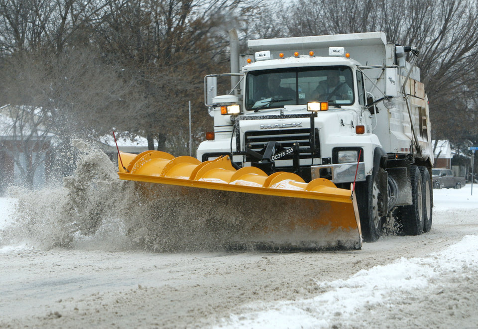 A snowplow clears snow and ice from Britton Rd. in Oklahoma City, OK, Friday, December 6, 2013,  Photo by Paul Hellstern, The Oklahoman