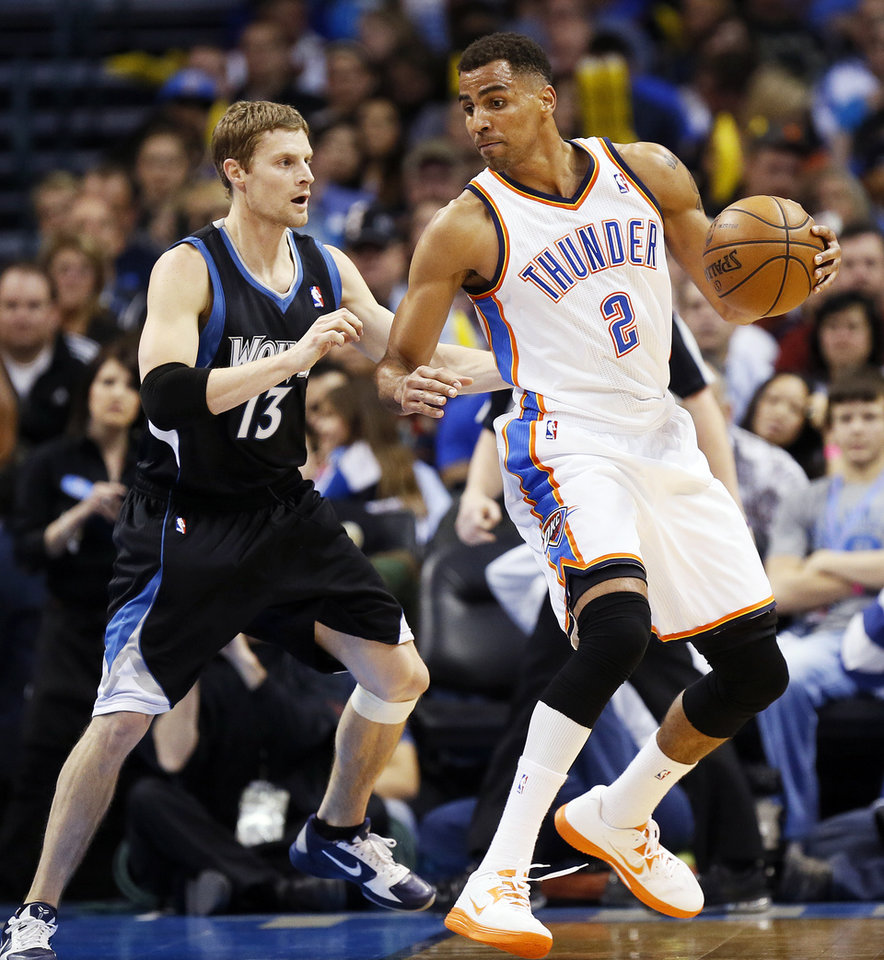 Oklahoma City\'s Thabo Sefolosha (2) works against Minnesota\'s Luke Ridnour (13) during an NBA basketball game between the Oklahoma City Thunder and Minnesota Timberwolves at Chesapeake Energy Arena in Oklahoma City, Friday, Feb. 22, 2013. Oklahoma City won, 127-111. Photo by Nate Billings, The Oklahoman