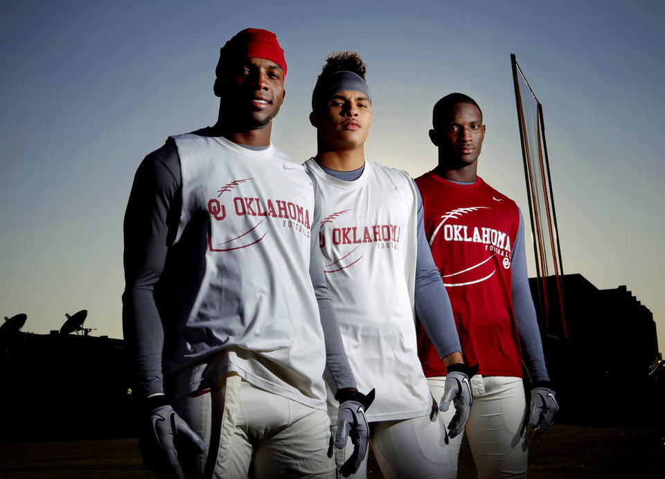 Oklahoma receivers Ryan Broyles, let, Kenny Stills, and Jaz Reynolds pose for a photo after practice in Norman, Okla., Tuesday, Oct. 18, 2011. Photo by Bryan Terry, The Oklahoman ORG XMIT: KOD