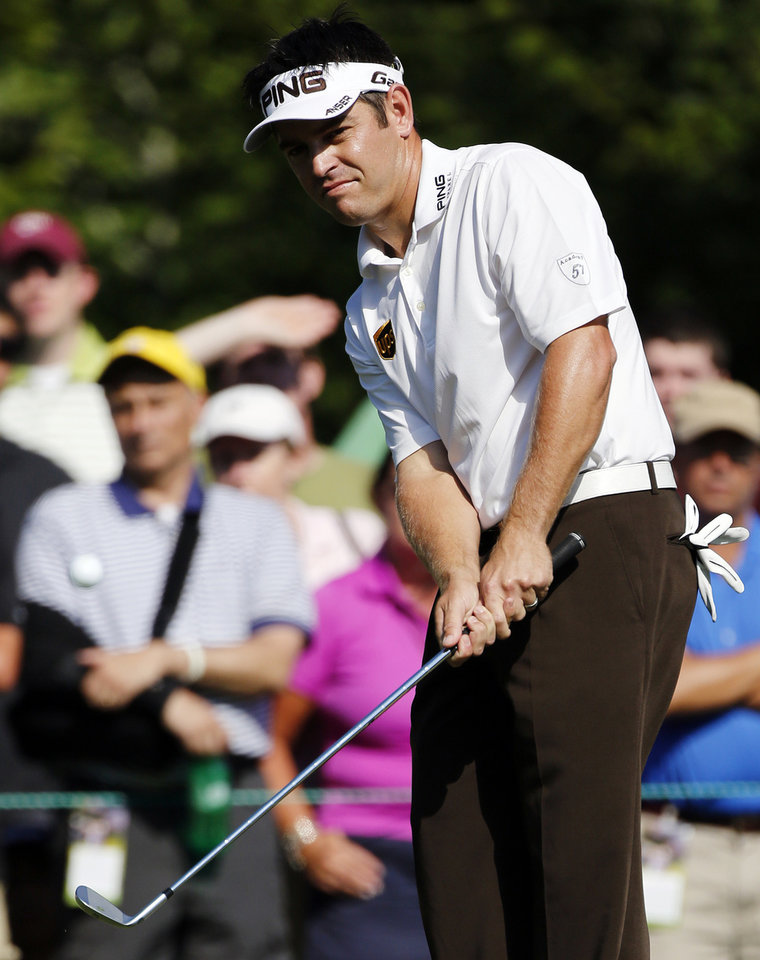 Photo -   Louis Oosthuizen, of South Africa, chips onto the seventh green during the third round of the Deutsche Bank Championship PGA golf tournament at TPC Boston in Norton, Mass., Sunday, Sept. 2, 2012. (AP Photo/Michael Dwyer)