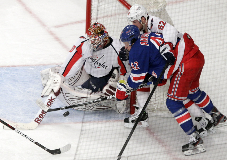 Photo -   New York Rangers' Artem Anisimov (42) scores a goal past Washington Capitals goalie Braden Holtby (70) as Mike Green helps to defend during the second period of Game 1 in the second round of the NHL hockey Stanley Cup playoffs Saturday, April 28, 2012, in New York. (AP Photo/Frank Franklin II)