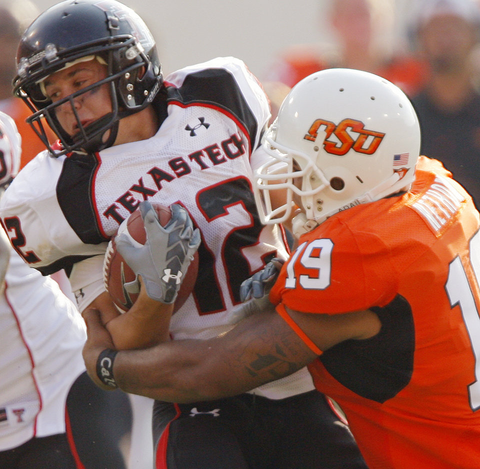 Oklahoma State's Jeremy Nethon (19) stops Texas Tech's Eric Morris (12) on a kick return during the second half of the college football game between the Oklahoma State University Cowboys (OSU) and the Texas Tech University Red Raiders (TTU) at Boone Pickens Stadium  on Saturday, Sept. 22, 2007, in Stillwater, Okla. 