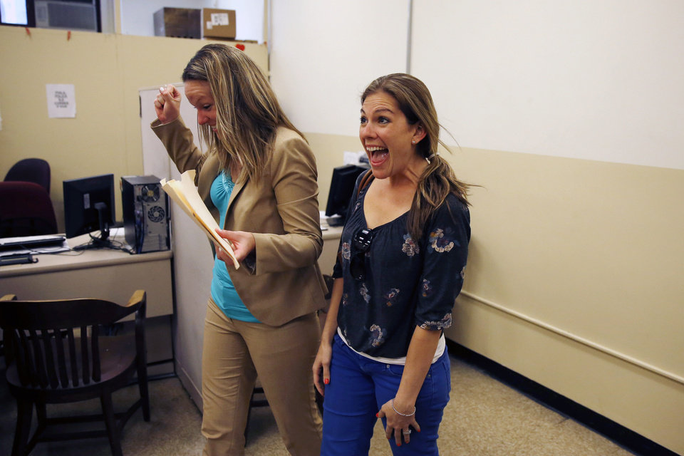 Photo - Ashley Wilson, left, and Lindsay Vandermay, right, both 29, react after getting their marriage license at the Philadelphia Marriage Bureau in City Hall, Tuesday, May 20, 2014, in Philadelphia. Pennsylvania's ban on gay marriage was overturned by a federal judge Tuesday. (AP Photo/Matt Slocum)