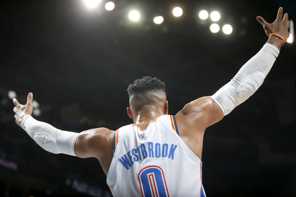 Photo - Oklahoma City's Russell Westbrook (0) celebrates from the bench during an NBA basketball game between the Oklahoma City Thunder and the Memphis Grizzlies at Chesapeake Energy Arena in Oklahoma City, Thursday, Feb. 7, 2019. Photo by Bryan Terry, The Oklahoman