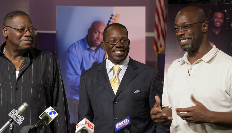 Photo - FAMILY: The brothers of former University of Oklahoma (OU) college basketball standout and award-winning jazz musician Wayman Tisdale, from left, Danny Tisdale, Rev. Weldon Tisdale and William Tisdale. smile as they recount events when they were children during a press conference at Rev. Tisdale's Baptist Church in Tulsa, Okla, Monday, May 18, 2009. The Tisdale brothers spoke publicly on Monday for the first time since Wayman's death on Friday at age 44 following a two-year fight with cancer. Wayman,a three-time All-American for the Sooners in the mid-1980s, was one of six children. (AP Photo/Tulsa World,Michael Wyke) ORG XMIT: OKTUL201