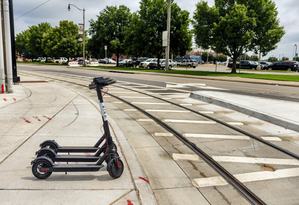 Photo - These Bird Ride Inc. electric scooters were for rent last week alongside the streetcar tracks in Bricktown. [Photo by Chris Landsberger, The Oklahoman]