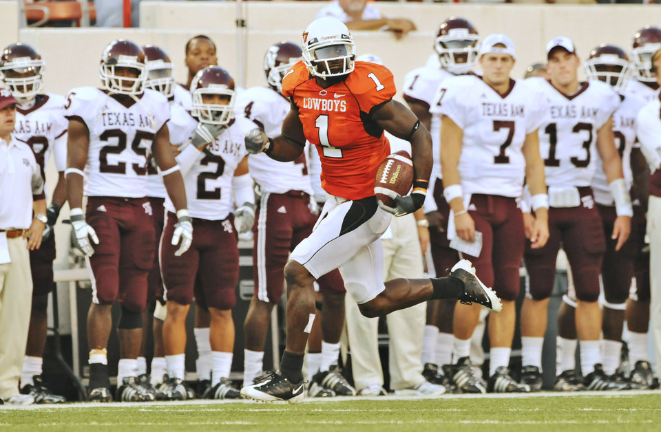 Photo - OSU: Oklahoma State University wide receiver Dez Bryant runs past the Texas A&M University bench on his way to a touchdown in the first quarter of an NCAA college football game in Stillwater, Okla., Saturday, Oct. 4, 2008. (AP Photo/Brody Schmidt) ORG XMIT: OKSO101