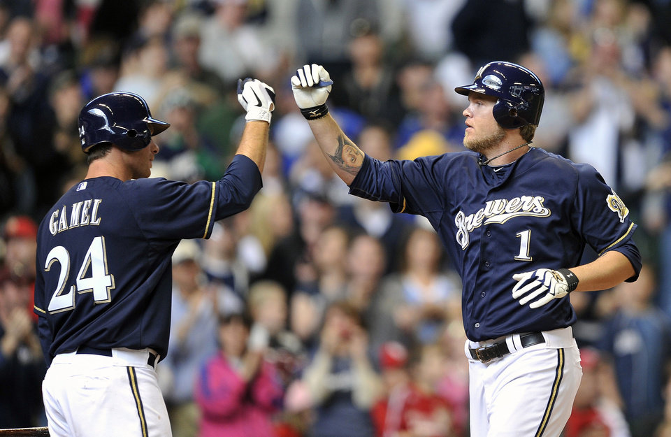 Photo -   Milwaukee Brewers' Mat Gamel (24) congratulates Corey Hart (1) after Hart's solo home run against the St. Louis Cardinals during the fifth inning of a baseball game, Sunday, April 8, 2012, in Milwaukee. (AP Photo/Jim Prisching)
