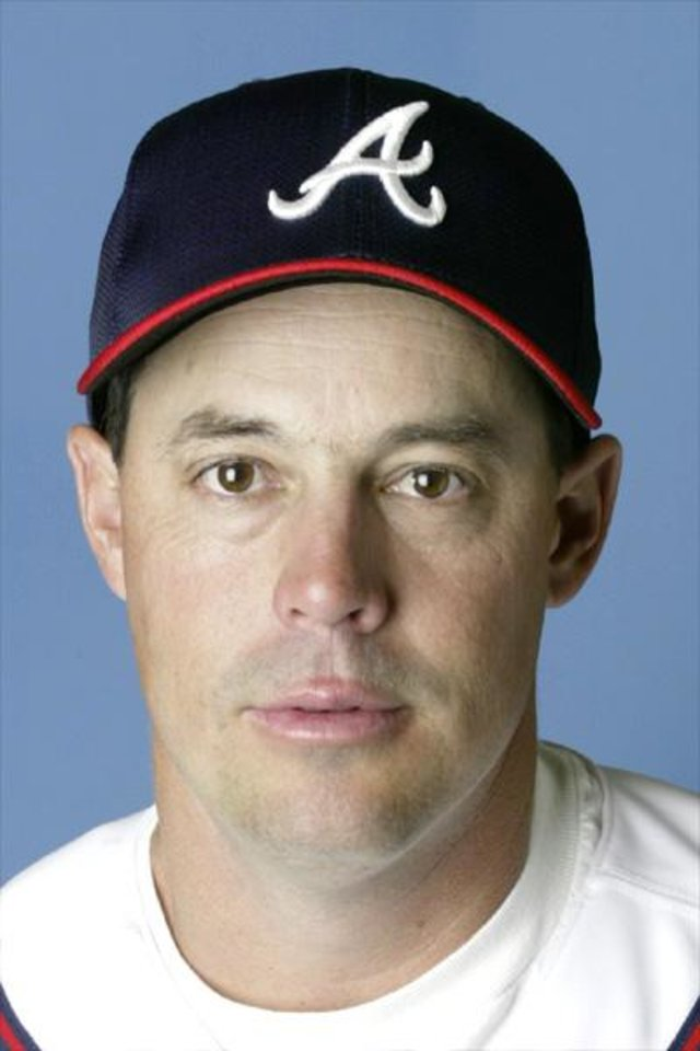 Photo - MAJOR LEAGUE BASEBALL: ** FILE ** This is a 2002 file photo of Greg Maddux of the Atlanta Braves. Maddux decided to stay with the Braves, accepting the team's offer of salary arbitration Thursday, Dec. 19, 2002.     The four-time Cy Young Award winner had been a free agent. Accepting arbitration is the equivalent of signing a one-year deal for the 2003 season.(AP Photo/file)