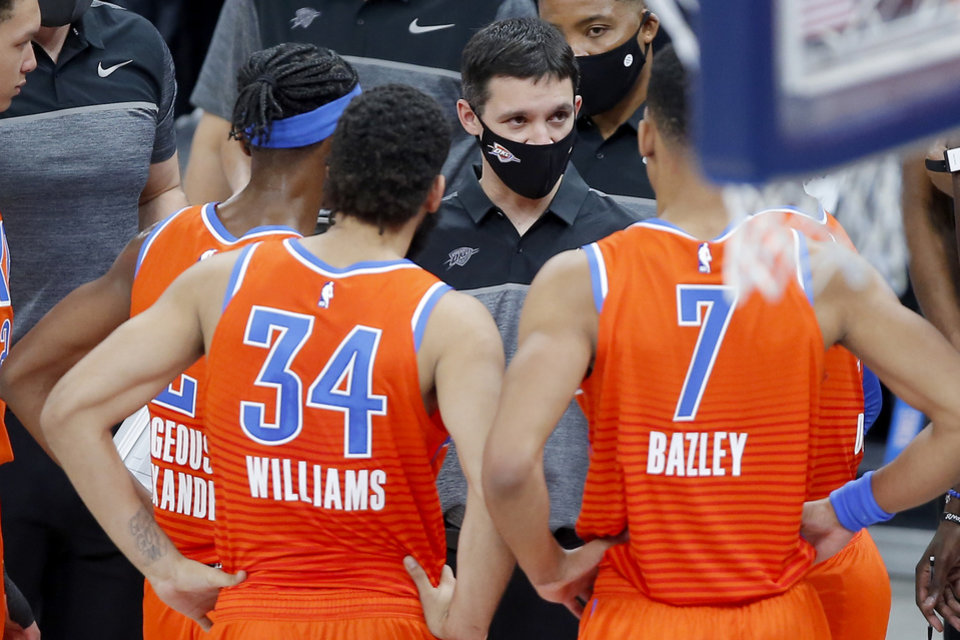 Photo - Oklahoma City coach Mark Daigneault talks with his team during an NBA basketball game between the Oklahoma City Thunder and the San Antonio Spurs at Chesapeake Energy Arena in Oklahoma City, Tuesday, Jan. 12, 2021.  San Antonio won 112-102. [Bryan Terry/The Oklahoman]