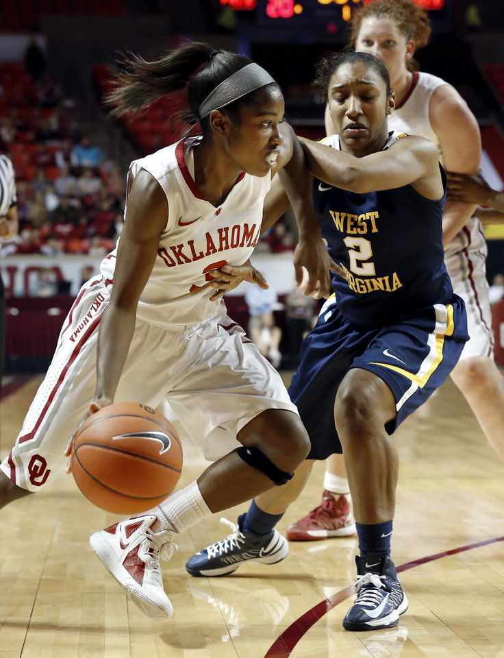 Oklahoma Sooner\'s Aaryn Ellenberg (3) drives around West Virginia Mountaineers\' Taylor Palmer (2) as the University of Oklahoma Sooners (OU) play the West Virginia Mountaineers in NCAA, women\'s college basketball at The Lloyd Noble Center on Wednesday, Jan. 2, 2013 in Norman, Okla. Photo by Steve Sisney, The Oklahoman