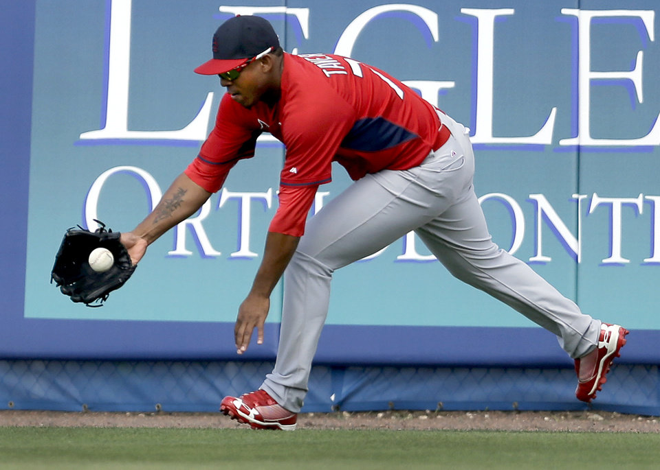 Photo - St. Louis Cardinals right fielder Oscar Taveras reaches for a ball hit off the outfield wall for a double by New York Mets' Travis d'Arnaud during the fifth inning of an exhibition spring training baseball game Friday, March 7, 2014, in Port St. Lucie, Fla. (AP Photo/Jeff Roberson)