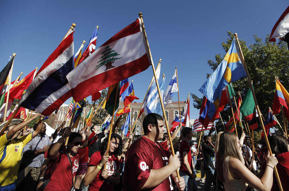 University of Oklahoma international students march during the University of Oklahoma Homecoming Parade in Norman, Okla., Saturday, Oct. 20, 2012.  Photo by Garett Fisbeck, The Oklahoman