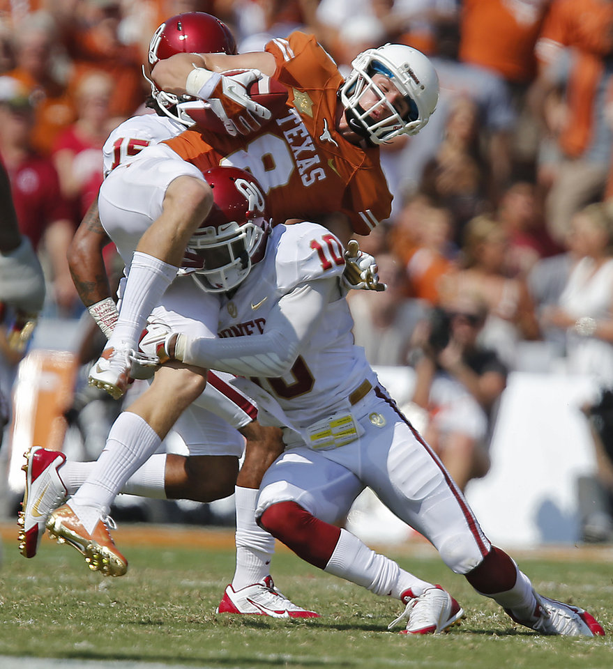 OU's Quentin Hayes (10) stops UT's Jaxon Shipley (8) during the Red River Rivalry college football game between the University of Oklahoma Sooners (OU) and the University of Texas Longhorns (UT) at the Cotton Bowl Stadium in Dallas, Saturday, Oct. 12, 2013. Photo by Chris Landsberger, The Oklahoman